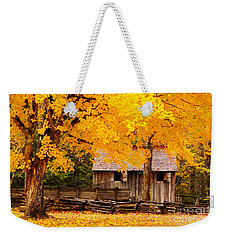 Weekender Tote Bag featuring the photograph Golden Cable Mill by Geraldine DeBoer