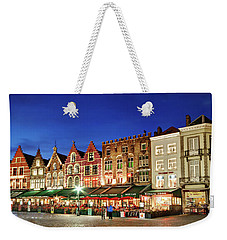 Weekender Tote Bag featuring the photograph Cafes And Restaurants On Markt Square - Bruges by Barry O Carroll