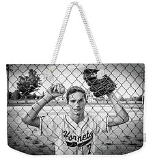 Weekender Tote Bag featuring the photograph Caged Competitor by Bill Pevlor