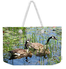 Weekender Tote Bag featuring the photograph Canada Geese Family On Lily Pond by Rose Santuci-Sofranko