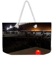 Weekender Tote Bag featuring the photograph Candle Lit Table Under The Bridge by Darcy Michaelchuk