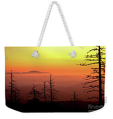 Weekender Tote Bag featuring the photograph Candy Corn Sunrise by Douglas Stucky