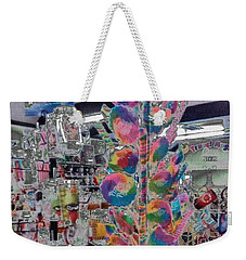Weekender Tote Bag featuring the photograph Candy Store by Kathie Chicoine