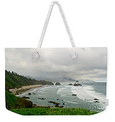 Weekender Tote Bag featuring the photograph Cannon Coast by Suzette Kallen