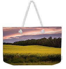 Weekender Tote Bag featuring the photograph Canola Crop Sunset by Darcy Michaelchuk
