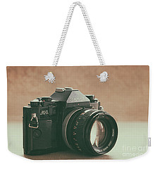 Weekender Tote Bag featuring the photograph Canon A1 by Ana V Ramirez