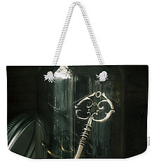 Weekender Tote Bag featuring the photograph Captive by Amy Weiss