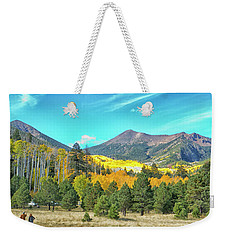 Weekender Tote Bag featuring the photograph Captured by Tom Kelly