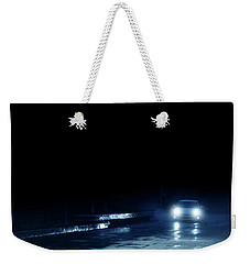 Car On A Rainy Highway At Night Weekender Tote Bag by Jill Battaglia