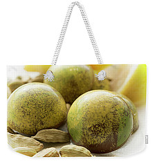 Weekender Tote Bag featuring the photograph Caradamon-lemon Chocolate by Sabine Edrissi