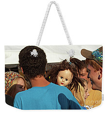 Weekender Tote Bag featuring the photograph Carnival Adoption by Joe Jake Pratt