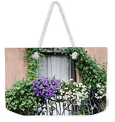 Weekender Tote Bag featuring the photograph Cascading Floral Balcony by Donna Corless
