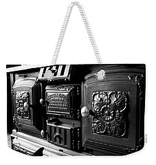 Weekender Tote Bag featuring the photograph Cast Iron Character by Greg Fortier