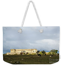 Weekender Tote Bag featuring the photograph Castle Ruin In Spotlight by Kennerth and Birgitta Kullman