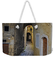Weekender Tote Bag featuring the photograph Cat On A Quiet Street In Viviers by Allen Sheffield