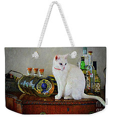 Weekender Tote Bag featuring the photograph Cat On The Liquor Cabinet by John Kolenberg