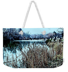 Weekender Tote Bag featuring the photograph Cattails On The Water by Sandy Moulder