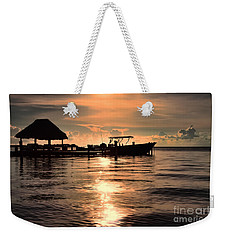 Weekender Tote Bag featuring the photograph Caye Caulker At Sunset by Lawrence Burry