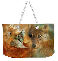Weekender Tote Bag featuring the mixed media Celestial Wolves 3 by Carol Cavalaris