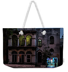 Weekender Tote Bag featuring the photograph Cell Phone Shop Havana Cuba by Charles Harden