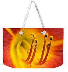 Weekender Tote Bag featuring the photograph Center Of A Lily by Jim Hughes
