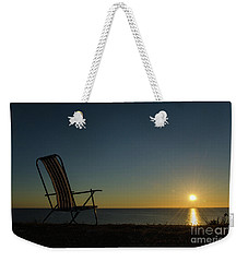 Weekender Tote Bag featuring the photograph Chair By The Setting Sun by Kennerth and Birgitta Kullman