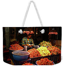 Weekender Tote Bag featuring the photograph Cheannai Flower Market Colors by Mike Reid