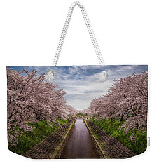 Weekender Tote Bag featuring the photograph Cherry Blossoms In Nara by Rikk Flohr