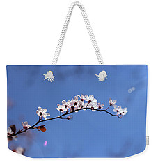 Weekender Tote Bag featuring the photograph Cherry Flowers With Lens Flare by Helga Novelli