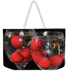 Weekender Tote Bag featuring the photograph Cherry In Glass by Elvira Ladocki