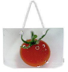 Weekender Tote Bag featuring the photograph Cherry Tomato In Water by Yumi Johnson