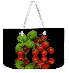 Weekender Tote Bag featuring the photograph Cherry Tomatoes And Basil by David French