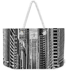 Weekender Tote Bag featuring the photograph Chicago Lasalle Street Black And White by Christopher Arndt