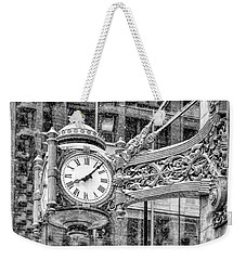 Weekender Tote Bag featuring the photograph Chicago Marshall Field State Street Clock Black And White by Christopher Arndt