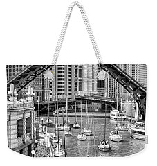 Weekender Tote Bag featuring the photograph Chicago River Boat Migration In Black And White by Christopher Arndt