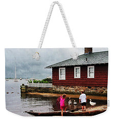 Weekender Tote Bag featuring the photograph Children Playing At Harbor Essex Ct by Susan Savad