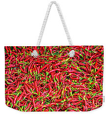 Weekender Tote Bag featuring the photograph Chillies by Charuhas Images