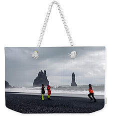 Weekender Tote Bag featuring the photograph China's Tourists In Reynisfjara Black Sand Beach, Iceland by Dubi Roman