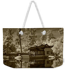 Weekender Tote Bag featuring the photograph Chinese Botanical Garden In California With Koi Fish In Sepia Tone by Randall Nyhof