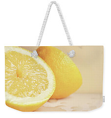 Weekender Tote Bag featuring the photograph Chopped Lemon by Lyn Randle