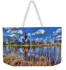 Church Along The Amstel River Weekender Tote Bag by Nadia Sanowar