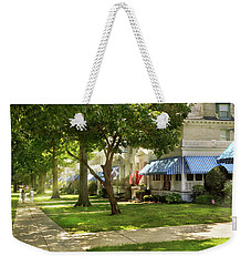 Weekender Tote Bag featuring the photograph City - Naval Academy - A Walk Down Captains Row by Mike Savad