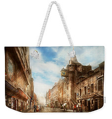 Weekender Tote Bag featuring the photograph City - Scotland - Tolbooth Operator 1865 by Mike Savad