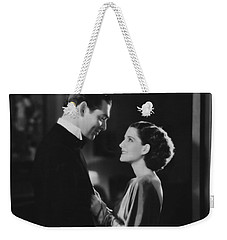 Weekender Tote Bag featuring the photograph Clark Gable Staring In A Free Soul by R Muirhead Art