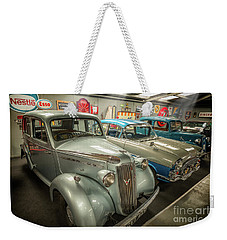 Weekender Tote Bag featuring the photograph Classic Car Memorabilia by Adrian Evans