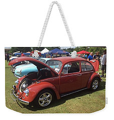 Weekender Tote Bag featuring the photograph Classic Red Bug by Aaron Martens