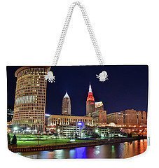Weekender Tote Bag featuring the photograph Cle Over The Cuyahoga by Frozen in Time Fine Art Photography