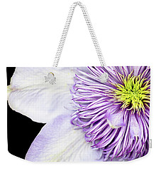 Weekender Tote Bag featuring the photograph Clematis Center by Rebecca Cozart