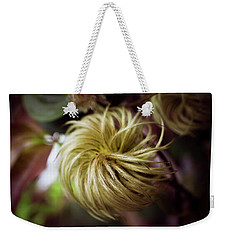 Weekender Tote Bag featuring the photograph Clematis Seed Head by Chrystal Mimbs