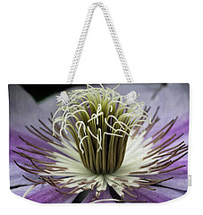 Weekender Tote Bag featuring the photograph Clematis World by Michael Friedman